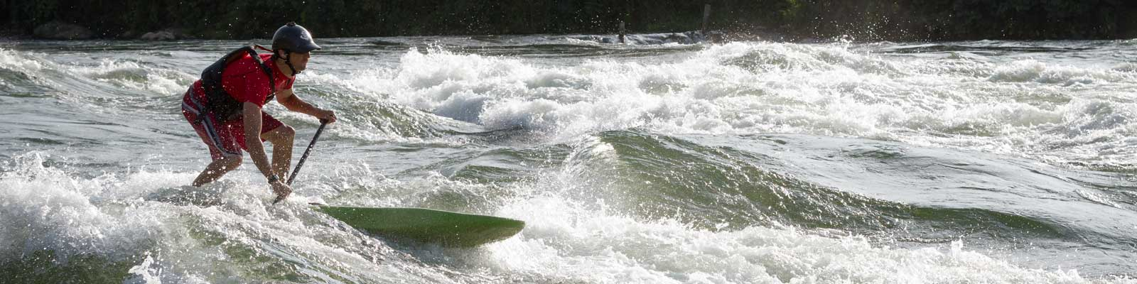 Stand up paddleboarding in the whitewater on the Nile